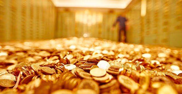 الذهب يسجل أعلى سعر في أسبوع مع هبوط الدولار