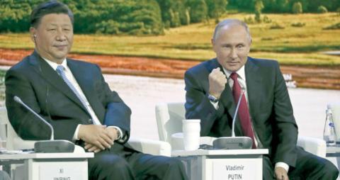 هل شجعت سياسات واشنطن الخارجية على تقارب روسي صيني؟