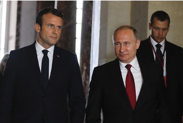 ماكرون وميركل يحضان بوتين على دعم جهود أوروبا بشأن إيران