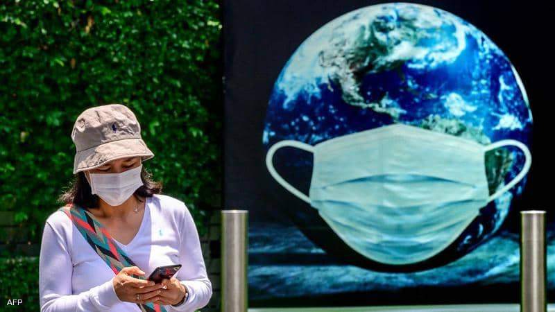 الصحة العالمية تدعو المطعّمين ضد كورونا للالتزام بالكمامات
